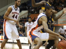 Junior forward Phillip Car dribbles for better position against Coppin State University. Photo by Wyman Jones.