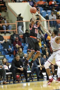Sophomore guard Antonio Gillespie shoots a three-pointer in a loss to NCCU. Photo by Terry Wright.