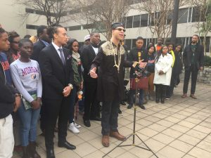Morgan State University student Chinedu Nwokeafor, flanked by students from the schools within the HBCU coalition, speaking on the site of Tuesday's hearing. Photo by Devon Ashby