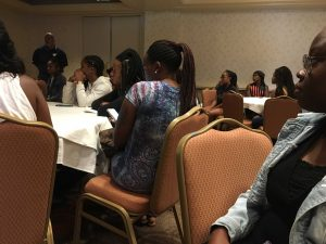 Students and their parents listening to Morgan State officials go over rules while staying in hotel.